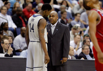 COLUMBUS, OH - MARCH 18: Head coach John Thompson III of the Georgetown Hoyas speaks to Henry Sims #14 in the first half against the North Carolina State Wolfpack during the third round of the 2012 NCAA Men's basketball tournament at Nationwide Arena on M