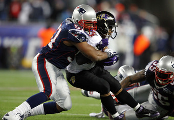FOXBORO, MA - JANUARY 22:   Jerod Mayo #51 of the New England Patriots tackles Ray Rice #27 of the Baltimore Ravens during their AFC Championship Game at Gillette Stadium on January 22, 2012 in Foxboro, Massachusetts.  (Photo by Al Bello/Getty Images)
