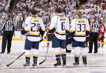 GLENDALE, AZ - MAY 07:  (L-R) Ryan Suter #20, Shea Weber #6 and Colin Wilson #33 of the Nashville Predators stand attended for the National Anthem before Game Five of the Western Conference Semifinals against the Phoenix Coyotes during the 2012 NHL Stanle