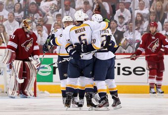 GLENDALE, AZ - APRIL 29:  The Nashville Predators celebrate after Ryan Suter #20 scored a thrid period goal against goaltender Mike Smith #41 of the Phoenix Coyotes in Game Two of the Western Conference Semifinals during the 2012 NHL Stanley Cup Playoffs
