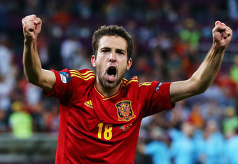 DONETSK, UKRAINE - JUNE 27: Jordi Alba of Spain celebrates victory during the UEFA EURO 2012 semi final match between Portugal and Spain at Donbass Arena on June 27, 2012 in Donetsk, Ukraine.  (Photo by Martin Rose/Getty Images)