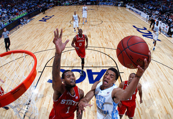 ATLANTA, GA - MARCH 10:  James Michael McAdoo #43 of the North Carolina Tar Heels drives against Richard Howell #1 of the North Carolina State Wolfpack during the semifinals of the 2012 ACC Men's Basketball Conference Tournament at Philips Arena on March