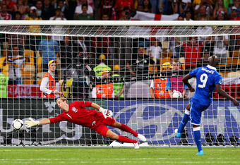 KIEV, UKRAINE - JUNE 24: Mario Balotelli of Italy scores his penalty past Joe Hart of England during the shoot out during the UEFA EURO 2012 quarter final match between England and Italy at The Olympic Stadium on June 24, 2012 in Kiev, Ukraine.  (Photo by