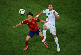 DONETSK, UKRAINE - JUNE 27: Jesus Navas of Spain competes with Pepe of Portugal  during the UEFA EURO 2012 semi final match between Portugal and Spain at Donbass Arena on June 27, 2012 in Donetsk, Ukraine.  (Photo by Lars Baron/Getty Images)