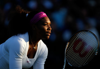 LONDON, ENGLAND - JUNE 30:   Serena Williams  of the USA in action while playing with Venus Williams of the USA during their Ladies' Doubles second round match against Maria Kirilenko and Nadia Petrova of Russia on day six of the Wimbledon Lawn Tennis Cha