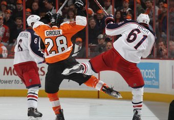 PHILADELPHIA - JANUARY 19: Rick Nash #61 of the Columbus Blue Jackets bounces off Claude Giroux #28 of the Philadelphia Flyers at the Wachovia Center on January 19, 2010 in Philadelphia, Pennsylvania.  (Photo by Bruce Bennett/Getty Images)
