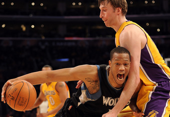 LOS ANGELES, CA - FEBRUARY 29:  Anthony Randolph #15 of the Minnesota Timberwolves is fouled as he dribbles by Troy Murphy #14 of the Los Angeles Lakers at Staples Center on February 29, 2012 in Los Angeles, California.  NOTE TO USER: User expressly ackno