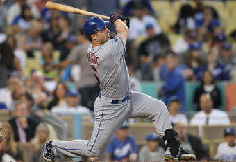 LOS ANGELES, CA - JUNE 28:  David Wright #5 of the New York Mets hits a solo homerun in the fourth inning during the MLB game against the Los Angeles Dodgers at Dodger Stadium on June 28, 2012 in Los Angeles, California.  (Photo by Victor Decolongon/Getty