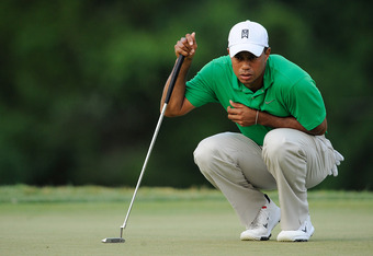 BETHESDA, MD - JUNE 30:  Tiger Woods lines up a putt on the 18th green during Round Three of the AT&T National at Congressional Country Club on June 30, 2012 in Bethesda, Maryland.  (Photo by Patrick McDermott/Getty Images)
