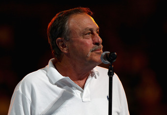MELBOURNE, AUSTRALIA - JANUARY 16:  Former Australian tennis player John Newcombe officially opens the 2012 Australian Open during day one of the 2012 Australian Open at Melbourne Park on January 16, 2012 in Melbourne, Australia.  (Photo by Mark Dadswell/