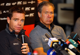 LIEGE, BELGIUM - JUNE 29:  Defending champion Cadel Evans (L) of Australia riding for BMC Racing Team addresses the media along with director Jim Ochowicz (R) during a press conference prior to the 2012 Tour de France on June 29, 2012 in Liege, Belgium.