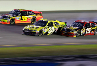 SPARTA, KY - JUNE 30:  Joey Logano, driver of the #20 Dollar General Toyota, races Clint Bowyer, driver of the #15 5-hour Energy Toyota, and Ryan Newman, driver of the #39 Tornados Chevrolet, during the NASCAR Sprint Cup Series Quaker State 400 at Kentuck