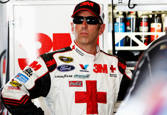 SPARTA, KY - JUNE 29: Greg Biffle, driver of the #16 American Red Cross Ford, stands in the garage during practice for the NASCAR Sprint Cup Series Quaker State 400 at Kentucky Speedway on June 29, 2012 in Sparta, Kentucky.  (Photo by Sean Gardner/Getty I