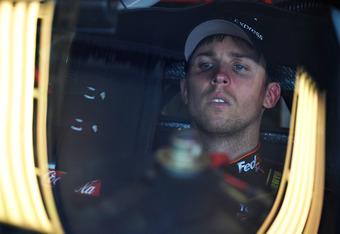 SPARTA, KY - JUNE 29:  Denny Hamlin, driver of the #11 FedEx Express Toyota, sits in his car during practice for the NASCAR Sprint Cup Series Quaker State 400 at Kentucky Speedway on June 29, 2012 in Sparta, Kentucky.  (Photo by Rainier Ehrhardt/Getty Ima
