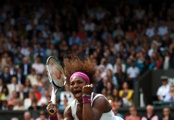LONDON, ENGLAND - JUNE 30:  Serena Williams of the USA celebrates match point during her Ladies' Singles third round match against Jie Zheng of China on day six of the Wimbledon Lawn Tennis Championships at the All England Lawn Tennis and Croquet Club at