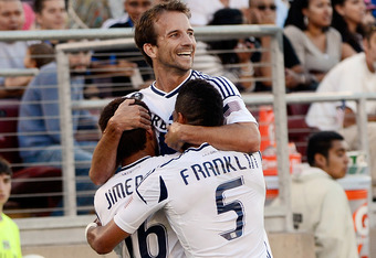 PALO ALTO, CA - JUNE 30:  Sean Franklin #5, Hector Jimenez #16 and Mike Magee #18 of the Los Angeles Galaxy celebrates after Jimenez scored a goal in the first half against the San Jose Earthquakes at Stanford Stadium on June 30, 2012 in Palo Alto, Califo