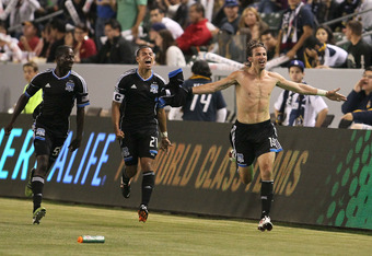 CARSON, CA - MAY 23:  Alan Gordon #16 of the San Jose Earthquakes (R) celebrates his 90th minute eventual game-winning goal as teammates (L-R) Ike Opara #55 and Jason Hernandez #21 run along and celebrate in the second half against the Los Angeles Galaxy