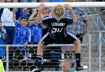 PALO ALTO, CA - JUNE 30:  Steven Lenhart #24 of the San Jose Earthquakes scores a goal and celebrates by doing pullups over the head of goal keeper  Josh Saunders #12 of the Los Angeles Galaxy in the first half of their MLS game at Stanford Stadium on Jun
