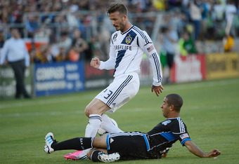 PALO ALTO, CA - JUNE 30:  David Beckham #23 of the Los Angeles Galaxy battles for control of the ball with Justin Morrow #15 of the San Jose Earthquakes in the first half of their MLS soccer game at Stanford Stadium on June 30, 2012 in Palo Alto, Californ