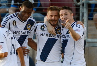 PALO ALTO, CA - JUNE 30: David Junior Lopes #3, David Beckham #23 and Robbie Keane #7 of the Los Angeles Galaxy celebrates after Beckham scored a goal on a free kick in the first half against the San Jose Earthquakes at Stanford Stadium on June 30, 2012 i