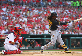 ST. LOUIS, MO - JUNE 29: Andrew McCutchen #22 of the Pittsburgh Pirates hits a double against the St. Louis Cardinals at Busch Stadium on June 29, 2012 in St. Louis, Missouri.  (Photo by Dilip Vishwanat/Getty Images)
