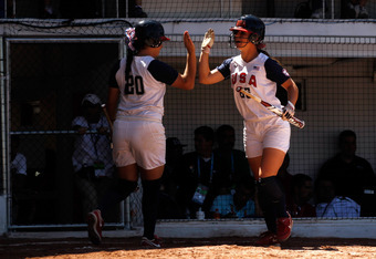 GUADALAJARA, MEXICO - OCTOBER 23:  Lauren Gibson #25 of the United States scores a run and gives a high five to teammate Valerie Arioto #20 in the fourth inning as Gibson scores on a single by Amelia Leles #31 during the gold medal softball game on Day Ni