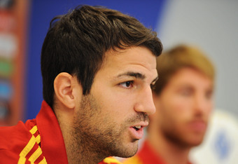 KIEV, UKRAINE - JUNE 29:  Cesc Fabregas of Spain talks to the media besides his teammate Sergio Ramos during a press conference ahead of the UEFA EURO 2012 final match against Italy on June 29, 2012 in Kiev, Ukraine.  (Photo by Jasper Juinen/Getty Images)