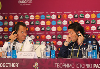 KIEV, UKRAINE - JUNE 30:  In this handout image provided by UEFA, Coach Cesare Prandelli of Italy and Gianluigi Buffon talk to the media during a UEFA EURO 2012 press conference at the Olympic Stadium on June 30, 2012 in Kiev, Ukraine.  (Photo by Handout/