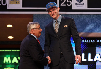 NEWARK, NJ - JUNE 28:  Tyler Zeller (R) of the North Carolina Tar Heels greets NBA Commissioner David Stern (L) after he was selected number seventeen overall by the Minnesota Timberwolves during the first round of the 2012 NBA Draft at Prudential Center