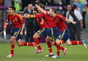 DONETSK, UKRAINE - JUNE 27:  Jesus Navas, Sergio Ramos and Andres Iniesta of Spain celebrate the winning penalty during the UEFA EURO 2012 semi final match between Portugal and Spain at Donbass Arena on June 27, 2012 in Donetsk, Ukraine.  (Photo by Alex L