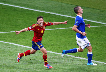 KIEV, UKRAINE - JULY 01:  Jordi Alba (L) of Spain celebrates next to Leonardo Bonucci of Italy after scoring his team's second goal during the UEFA EURO 2012 final match between Spain and Italy at the Olympic Stadium on July 1, 2012 in Kiev, Ukraine.  (Ph