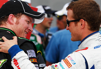 BROOKLYN, MI - JUNE 17:  Dale Earnhardt Jr., driver of the #88 Diet Mountain Dew/TheDarkKnightRises/National Guard/ Chevrolet, is congratulated by Kasey Kahne, driver of the #5 Farmers Insurance Chevrolet, in Victory Lane after Earnhardt  won the NASCAR S