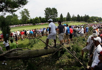 BETHESDA, MD - JULY 01: Fans follow the second shot of Tiger Woods (not pictured) along the number one fairway during the Final Round of the AT&T National at Congressional Country Club on July 1, 2012 in Bethesda, Maryland.  (Photo by Rob Carr/Getty Image