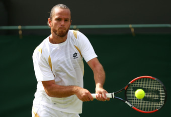 LONDON, ENGLAND - JUNE 29:  Xavier Malisse of Belgium hits a backhand return during his Gentlemen's Singles third round match against Fernando Verdasco of Spain on day five of the Wimbledon Lawn Tennis Championships at the All England Lawn Tennis and Croq
