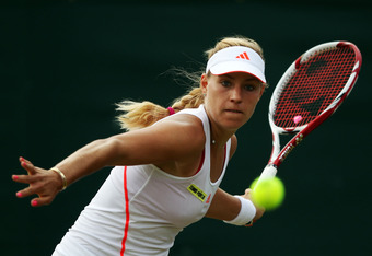 LONDON, ENGLAND - JUNE 29:  Angelique Kerber of Germany returns the ball during her Ladies' singles third round match against Christina McHale of USA on day five of the Wimbledon Lawn Tennis Championships at the All England Lawn Tennis and Croquet Club on