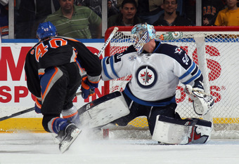 UNIONDALE, NY - APRIL 05: Michael Grabner #40 of the New York Islanders scores on the third period penalty shot against Chris Mason #50 of the Winnipeg Jets at the Nassau Veterans Memorial Coliseum on April 5, 2012 in Uniondale, New York. The Islanders de