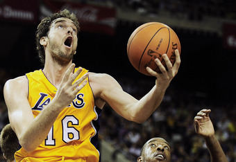 BARCELONA, SPAIN - OCTOBER 07:  Pau Gasol #16 (L) of the Los Angeles Lakers gets to the hoop against Terence Morris #23 of the Regal FC Barcelona during the NBA Europe Live match between Los Angeles Lakers and Regal FC Barcelona at the at Palau Blaugrana