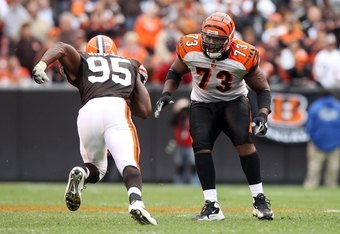 CLEVELAND - OCTOBER 04: Anthony Collins #73 of the Cincinnati Bengals defends against Kamerion Wimbley #95 of the Cleveland Browns during their game at Cleveland Browns Stadium on October 4, 2009 in Cleveland, Ohio. The Bengals defeated the Browns 23-20 i