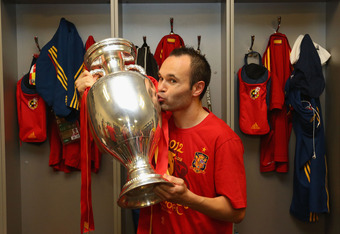 KIEV, UKRAINE - JULY 01: Andres Iniesta of Spain poses in the dressing room with the trophy following the UEFA EURO 2012 final match between Spain and Italy at the Olympic Stadium on July 1, 2012 in Kiev, Ukraine.  (Photo by Handout/UEFA via Getty Images)
