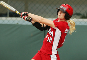 BEIJING - AUGUST 14:  Melanie Matthews #12 of Canada swings at a pitch against the United States during their preliminary softball game at the Fengtai Softball Field during Day 6 of the Beijing 2008 Olympic Games on August 14, 2008 in Beijing, China.  (Ph