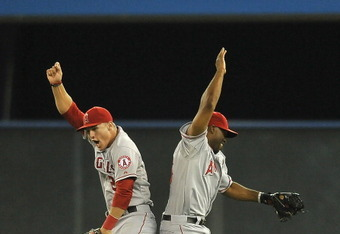 TORONTO, CANADA - JUNE 28:  Mike Trout #27 and Torii Hunter #48 of the of the Los Angeles Angels of Anaheim celebrate the teams win over the Toronto Blue Jays during MLB game action June 28, 2012 at Rogers Centre in Toronto, Ontario, Canada. (Photo by Bra