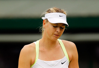 LONDON, ENGLAND - JULY 02:  Maria Sharapova of Russia shows her dejection during her Ladies' singles fourth round match against Sabine Lisicki of Germany on day seven of the Wimbledon Lawn Tennis Championships at the All England Lawn Tennis and Croquet Cl