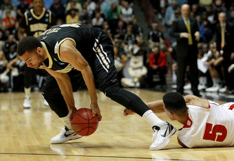 ALBUQUERQUE, NM - MARCH 17:  Jeffery Taylor #44 of the Vanderbilt Commodores picks up a loose ball against Ryan Evans #5 of the Wisconsin Badgers in the first half during the third round of the 2012 NCAA Men's Basketball Tournament at The Pit on March 17,