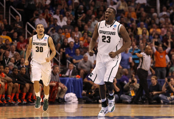 PHOENIX, AZ - MARCH 22:  (R-L) Draymond Green #23 and Brandon Wood #30 of the Michigan State Spartans react in the first half while taking on the Louisville Cardinals during the 2012 NCAA Men's Basketball West Regional Semifinal game at US Airways Center