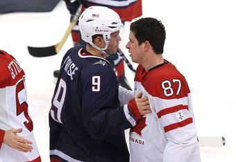 VANCOUVER, BC - FEBRUARY 28:  Zach Parise #9 of USA and Sidney Crosby #87 of Canada pat one another after shaking hands after the ice hockey men's gold medal game between USA and Canada on day 17 of the Vancouver 2010 Winter Olympics at Canada Hockey Plac