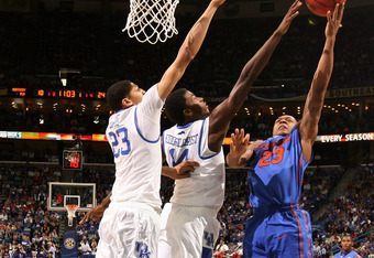 NEW ORLEANS, LA - MARCH 10:  Bradley Beal #23 of the Florida Gators shoots against Michael Kidd-Gilchrist #14 and Anthony Davis #23 of the Kentucky Wildcats in the first half during the semifinals of the SEC Men's Basketball Tournament at New Orleans Aren