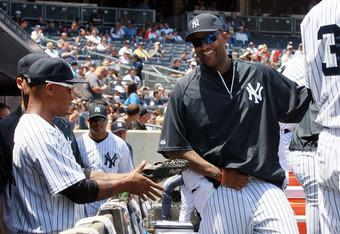 NEW YORK, NY - JUNE 27:  CC Sabathia #52 of the New York Yankees has a laugh in the dugout with teammate Dewayne Wise #45 during the game against the Cleveland Indians at Yankee Stadium on June 27, 2012  in the Bronx borough of New York City.  (Photo by J
