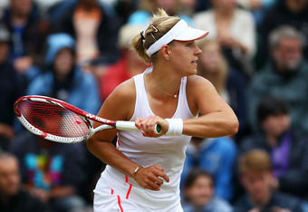 LONDON, ENGLAND - JULY 02:  Angelique Kerber of Germany returns the ball during her Ladies' singles fourth round match against Kim Clijsters of Belgium on day seven of the Wimbledon Lawn Tennis Championships at the All England Lawn Tennis and Croquet Club