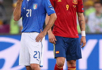KIEV, UKRAINE - JULY 01: Andrea Pirlo (L) of Italy and Fernando Torres of Spain during the UEFA EURO 2012 final match between Spain and Italy at the Olympic Stadium on July 1, 2012 in Kiev, Ukraine.  (Photo by Alex Livesey/Getty Images)