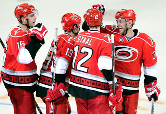 RALEIGH, NC - APRIL 05:  Teammates celebrate with Eric Staal #12 of the Carolina Hurricanes after his game-winning goal against the Montreal Canadiens during a shootout at PNC Arena on April 5, 2012 in Raleigh, North Carolina. The Hurricanes won 2-1 by sh